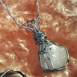 Jewelry - silver colour wire wrapped quartz crystal pendant